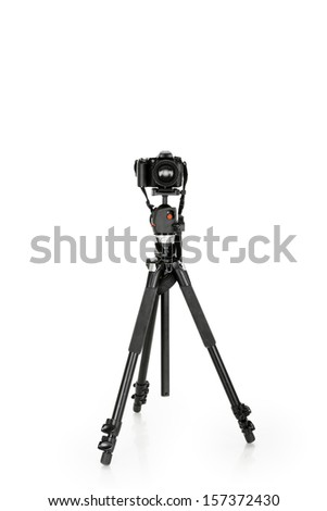 dslr camera on tripod on the white background - stock photo