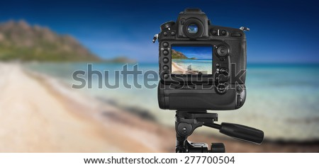 DSLR camera on tripod shooting seascape - these are all photos made by me, that you separately can find on my shutterstock portfolio. Logos, brand, or anything has been deleted to be 100% commercial.  - stock photo