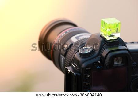 DSLR camera with Hotshoe Bubble spirit level  - stock photo
