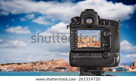 Dslr camera with zoom telephoto lens shooting on a cityscape in a sunny day - stock photo