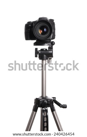 DSLR digital single lens reflex camera on a tripod isolated on white - stock photo