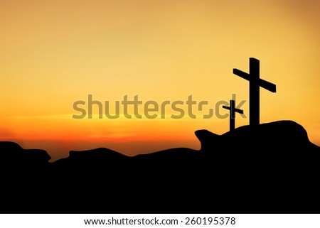 Dual cross on top a mountain.