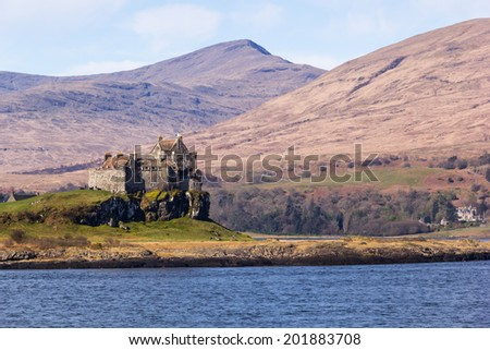 Duart Castle or Caisteal Dhubhairt in Scottish Gaelic is a castle on the Isle of Mull, off the west coast of Scotland. The castle dates back to the 13th century and is the seat of Clan MacLean. - stock photo