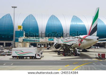 DUBAI - APRIL 23: Dubai International Airport on April 23, 2013 in Dubai, UAE. Emirates handles major part of passenger traffic and aircraft movements at the airport. - stock photo