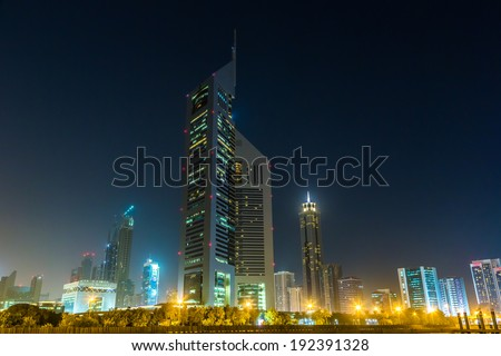 DUBAI - APRIL 18: Emirates Towers and Burj Khalifa at night time, 18 april 2013 in Dubai, UAE. Jumeirah Emirates Towers, Dubai's finest city hotel, is located in commercial business district.