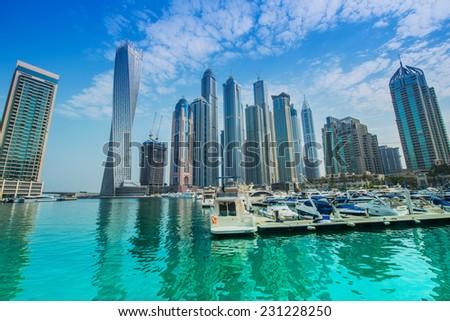 Dubai - AUGUST 9, 2014: Dubai Marina district on August 9 in UAE, Dubai. Dubai Marina district is a popular residential and business area. - stock photo