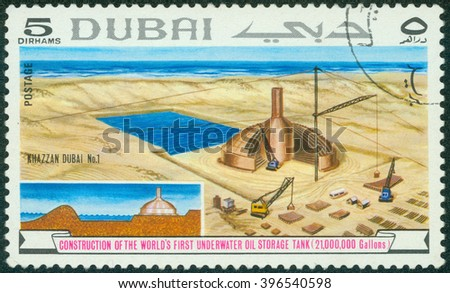 DUBAI - CIRCA 1983: stamp printed by Dubai, shows  construction of underwater oil storage tank, circa 1983 - stock photo