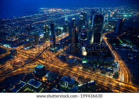 Dubai city evening. View from Dubai's tower 124th floor. - stock photo
