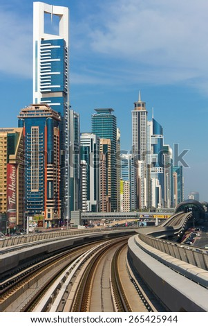 DUBAI CITY,UNITED ARAB EMIRATES-DECEMBER 5, 2013: Metro rails in modern part of Dubai city,United Arab Emirates - stock photo