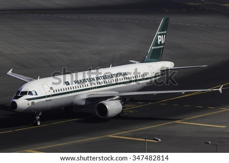 DUBAI - DECEMBER 5: A PIA (Pakistan International Airlines) A320 painted in the anniversary retro livery is taxing to the gate after arrival from Pakistan, Peshawar, as seen on December 5, 2015. - stock photo