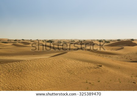 Dubai desert sand dunes  - stock photo