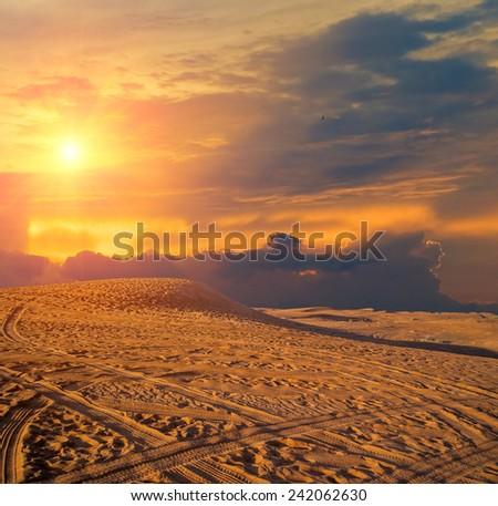 Dubai desert with beautiful sandunes during the sunrise - stock photo