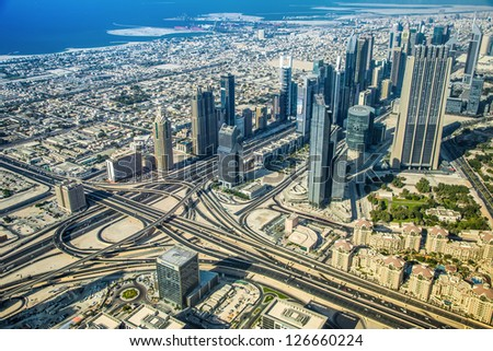 Dubai downtown day scene with city lights, luxury new high tech town in middle East, United Arab Emirates architecture - stock photo