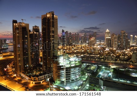 Dubai Downtown illuminated at dusk. United Arab Emirates