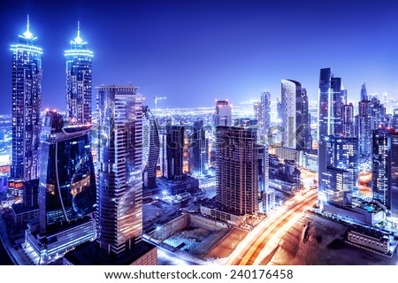 Dubai downtown night scene, UAE, beautiful modern buildings, bright glowing lights, luxurious travel and tourism  - stock photo