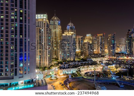 Dubai downtown night scene with city lights, luxury new high tech town in middle East  - stock photo