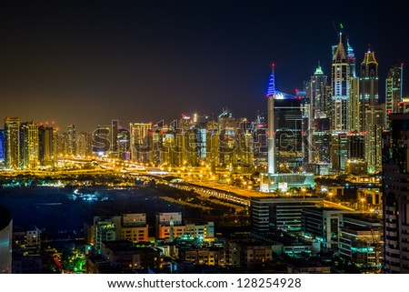 Dubai downtown night scene with city lights, luxury new high tech town in middle East, United Arab Emirates architecture - stock photo
