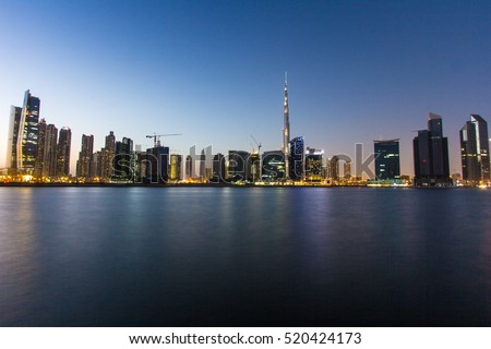 Dubai Downtown view after sunset as shot from a rooftop viewpoint. Dubai, UAE - 02/JUN/2016