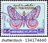 "DUBAI EMIRATE - CIRCA 1963: A stamp printed in United Arab Emirates from the ""Centenary of Red Cross"" issue shows March moth, circa 1963. - stock photo"