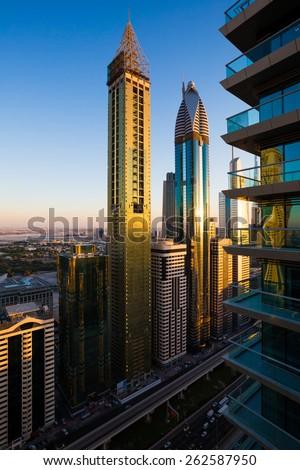 Dubai evening skyline.Dubai sunset time. Sunset light on Dubai skyscrapers. Rose Rayhaan by Rotana,Ahmed Abdul Rahim Al Attar Tower, 21st Century Tower Dubai. Dubai skyscrapers.Sheikh Zayed Road Dubai - stock photo