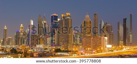 DUBAI FINANCIAL CENTER, UNITED ARAB EMIRATES - FEBRUARY 28, 2016: Panorama of Dubai Financial Center at the evening sunset,Dubai,United Arab Emirates