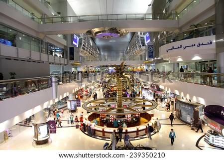 DUBAI INTERNATIONAL AIRPORT, DUBAI-DUBAI-JULY 25: Dubai International Airport with glorious duty free section on July 25, 2013. Dubai International is one of the fastest growing major hubs - stock photo