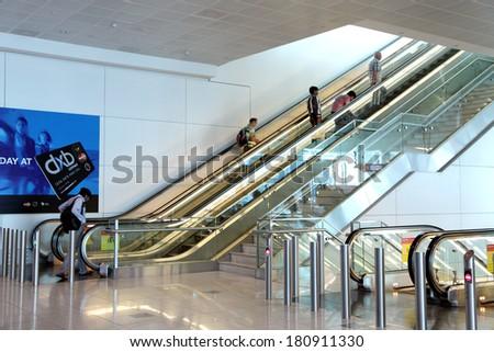 DUBAI INTERNATIONAL AIRPORT, DUBAI-OCTOBER 14: Escalator at Dubai International Airport on October 14, 2013. Dubai International is one of the fastest growing major hubs - stock photo