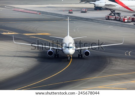 DUBAI - JANUARY 9: An Indian airline, Indigo, A320 plane is taxing to the gate after her arrival at the Dubai International Airport as seen on January 9, 2015. - stock photo