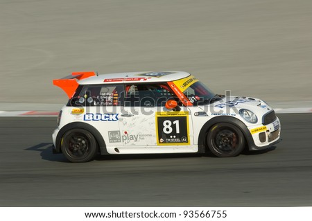 DUBAI - JANUARY 13: Car 81, a BMW Mini Cooper S, participating in the 2012 Dunlop 24 Hour Race at Dubai Autodrome on January 13, 2012.