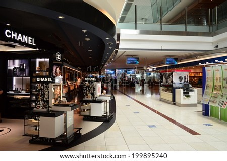 DUBAI - JUNE 20: A general view of duty free shopping in Dubai International Airport on June 20, 2014 in Dubai, UAE. Dubai airport is the largest in the Middle East region. - stock photo