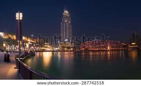Dubai - June 4 : Dubai Fountain show near Dubai mall, Souk Al Bahar ,Address hotel and Burj Khalifa the tallest building in the world on June 4,2015 in Dubai. - stock photo