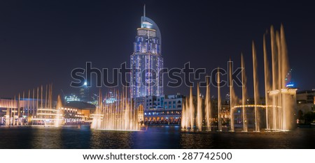 Dubai - June 4 : Dubai Fountain show near Dubai mall, Souk Al Bahar and Burj Khalifa the tallest building in the world on June 4,2015 in Dubai. - stock photo