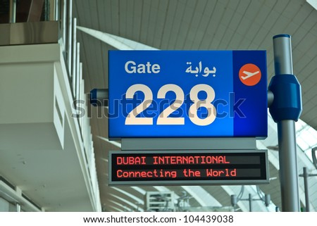 DUBAI - JUNE 02: Notice board at Dubai International airport on June 2, 2012 in Dubai, UAE. The airport is major aviation hub in the Middle East with max throughput of 80 millions  passengers per year - stock photo