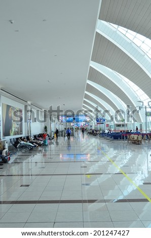 DUBAI - JUNE 20: Passenger lobby in Dubai International Airport on June 20, 2014 in Dubai, UAE. This airport is the biggest in Middle East region.