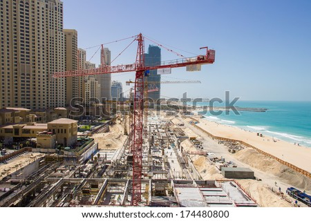 """DUBAI - MARCH 24, 2013: Large construction site for a new mall at the beach located at Dubai Marina next to """"The Walk"""" taken on March 24, 2013 in Dubai, United Arab Emirates. - stock photo"""