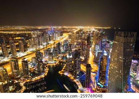 Dubai Marina from above. Dubai Marina by night. Dubai Marina skyscrapers. Cayan tower by night. - stock photo
