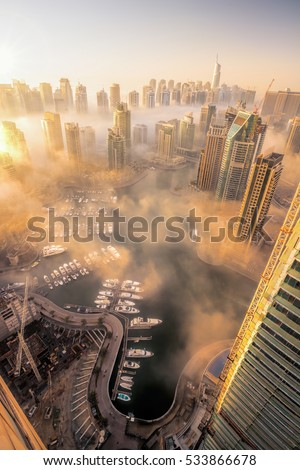 Dubai Marina is covered by early morning fog in Dubai, United Arab Emirates