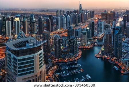 Dubai Marina rooftop skyline by night. United Arab Emirates.  - stock photo