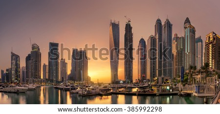 Dubai Marina Towers with glowing sunset - stock photo