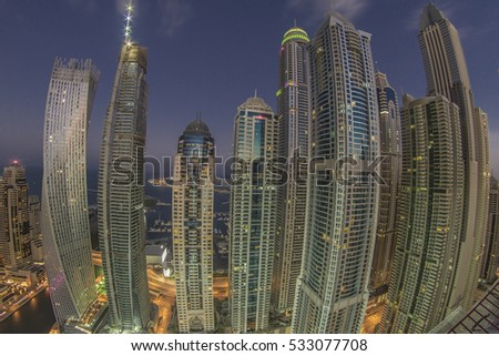 DUBAI MARINA, UAE - 7th DECEMBER 2016 : Dubai Marina skyscraper buildings through fish eye lens