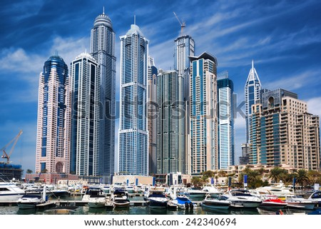 Dubai Marina with skyscrapers and boats in Dubai, United Arab Emirates - stock photo