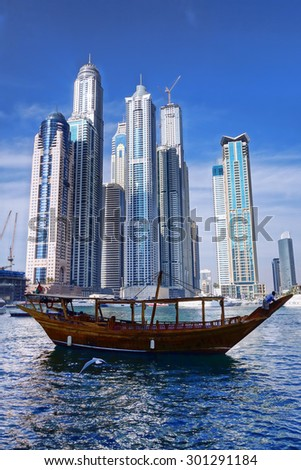 Dubai Marina with skyscrapers and boats in Dubai, United Arab Emirates - stock photo