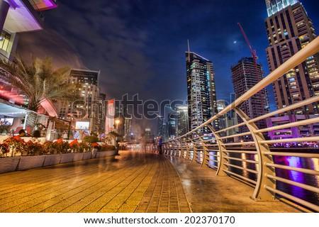 Dubai Marina with skyscrapers in Dubai, United Arab Emirates  - stock photo
