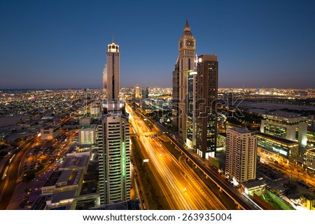 Dubai night skyline. Dubai streets by night. Al Yaqoub tower Dubai. Dubai Millennium Plaza. Dubai Sheikh Zayed Road by night.  Dubai night view. Dubai cityscape by night. Dubai metro station view. - stock photo