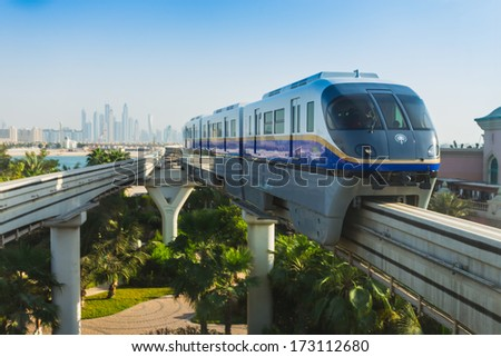 DUBAI - NOVEMBER 3: Monorail station on a man-made island Palm Jumeirah on Novrmber 3, 2013 in Dubai, UAE. This monorail is the longest completely automated rail system. - stock photo