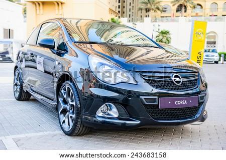 "DUBAI - NOVEMBER 26: New cars presentation at yearly automotive-show ""MECONTI"" event. November 26, 2014 in Dubai, United Arab Emirates. - stock photo"