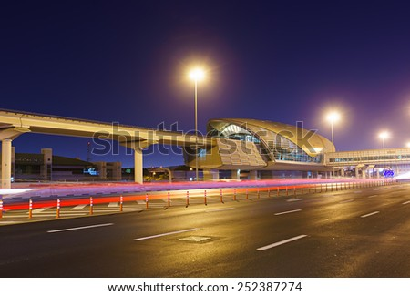 DUBAI - OCT 14: Dubai metro at night on October 14, 2014. Dubai is the most populous city and emirate in the UAE, and the second largest emirate by territorial size after the capital, Abu Dhabi - stock photo