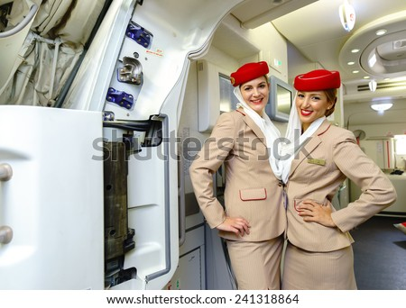 DUBAI - OCT 17: Emirates crew members meet passengers in Airbus A380 aircraft on October 17, 2014 in Dubai, UAE. Emirates handles major part of passenger traffic and aircraft movements at the airport. - stock photo