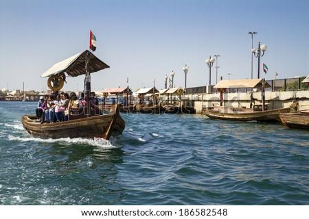 DUBAI - OCTOBER 30: Abra boat ride on October 30, 2014 in old Dubai, UAE. Abras are used to ferry people across the Dubai Creek in Dubai, United Arab Emirates. - stock photo