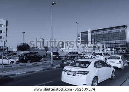 DUBAI - OCTOBER 22, 2015: City traffic on a beautiful day. Dubai traffic can be very high during peak hours.